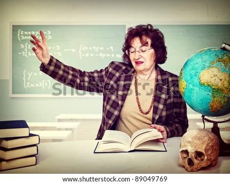 caucasian old teacher take lesson at school - stock photo
