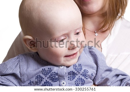 Caucasian portrait of a smiling baby. white background. - stock photo