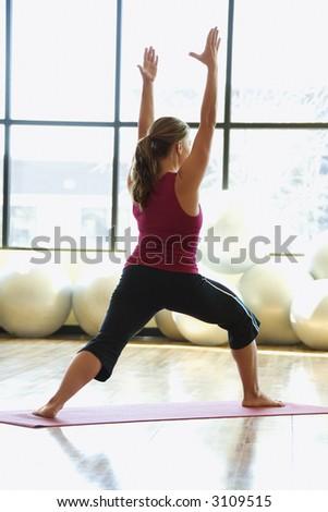 Caucasian prime adult female doing yoga. - stock photo