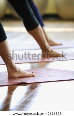 Caucasian prime adult females in yoga class. - stock photo