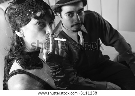 Caucasian prime adult male looking at Caucasian prime adult female looking at viewer. - stock photo