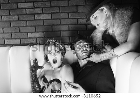 Caucasian prime adult male torn between two Caucasian prime adult females. - stock photo