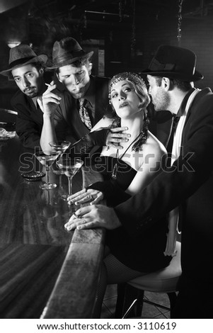 Caucasian prime adult retro female sitting at bar surrounded by suitors. - stock photo