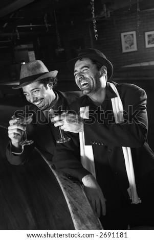 Caucasian prime adult retro males sitting at bar drinking. - stock photo