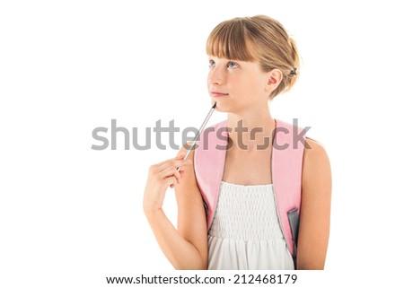 Caucasian schoolgirl wondering about something. - stock photo