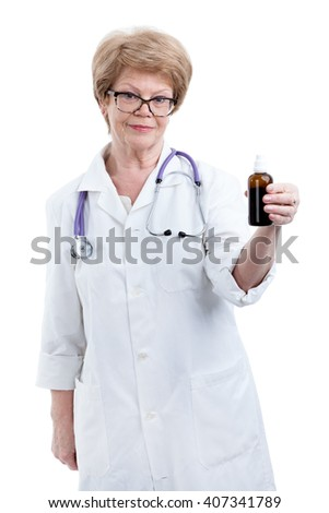 Caucasian senior doctor in eyeglasses showing bottle with liquid drugs, isolated on white background
