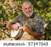 Caucasian Senior Man Playing the Banjo Outdoors. - stock photo
