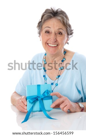 Caucasian senior woman whit gift box, isolated over white background.  - stock photo