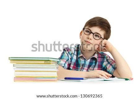 Caucasian smiling boy at his desk on white background with copy space - stock photo