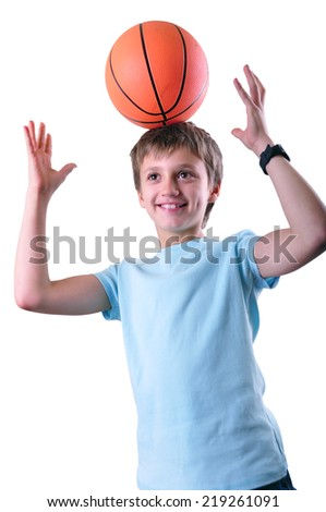 Caucasian smiling boy, basketball player having fun with a ball on his head isolated on white background.  - stock photo