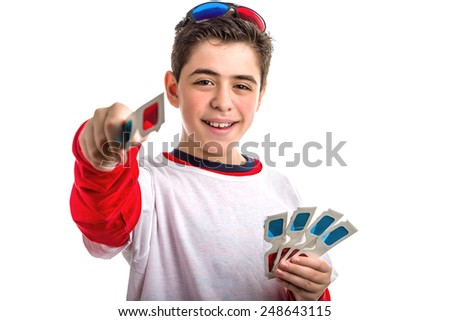 Caucasian smooth-skinned boy wears a pair of black 3D Cinema paper eyeglasses on head with red and blue lenses and holds 4 white googles with left hand while offering and giving one with right hand - stock photo