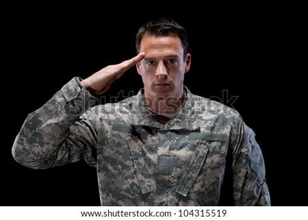 Caucasian soldier salutes - stock photo