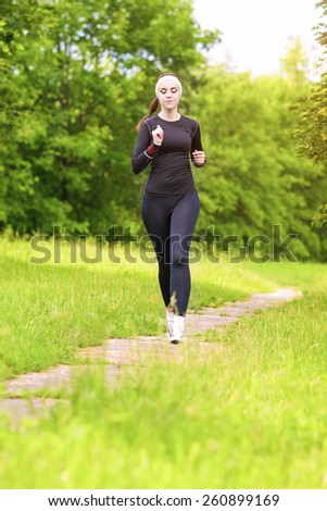 Caucasian Sportwoman Having Her Regular Training Outdoors. Vertical Composition - stock photo