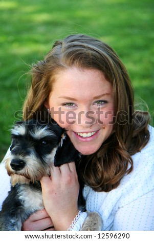 Caucasian teenage girl with brown hair with her dog