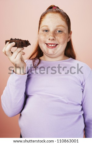 Caucasian Teenage Girl With Pastry - stock photo