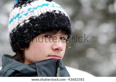 Caucasian teenager in winter scene - stock photo