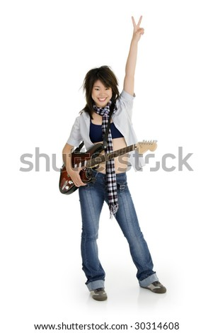 Caucasian teenager posing as a punk rocker on white background - stock photo
