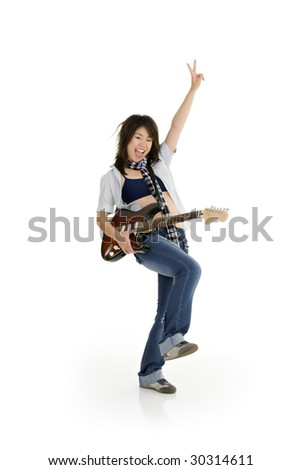 Caucasian teenager posing as a punk rocker on white background