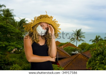caucasian teenager wearing a face mask. concept picture: swine flu on holidays - stock photo