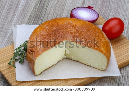 Caucasian traditional Suluguni cheese with rosemary, tomaro and thyme