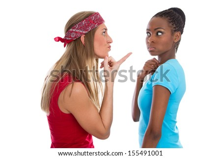Caucasian woman blaming her african friend - stock photo