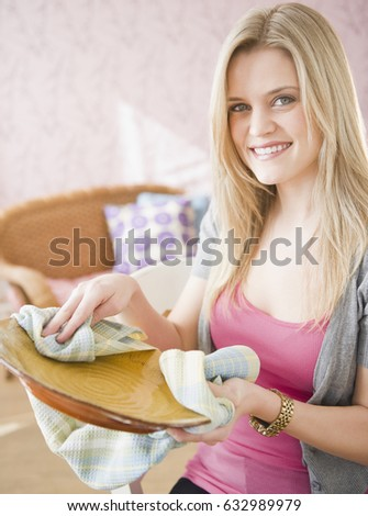 Caucasian woman drying plate