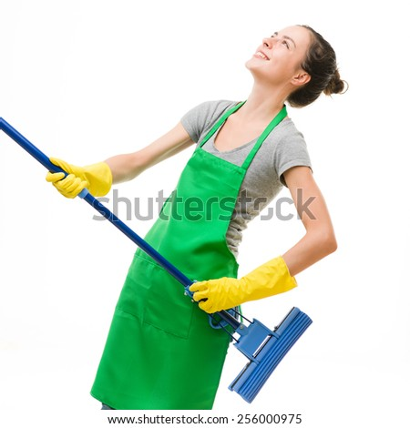 caucasian woman enjoying cleaning by playing air guitar with mop, on white background - stock photo