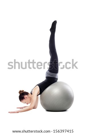 caucasian woman exercising pilates poses, isolated in studio - stock photo