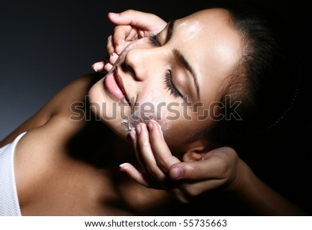 Caucasian woman getting facial done - stock photo