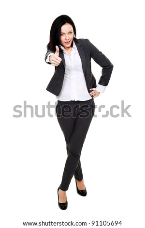 Caucasian woman giving thumbs up over white background - stock photo