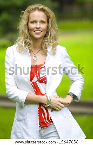 caucasian woman have fun in park - stock photo