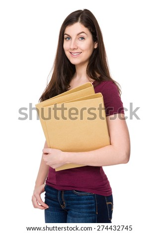 Caucasian woman hold with folder - stock photo