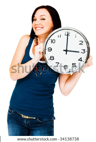 Caucasian woman holding a clock isolated over white - stock photo
