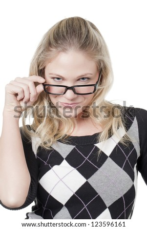 Caucasian woman holding her eye glasses as she looks in front - stock photo