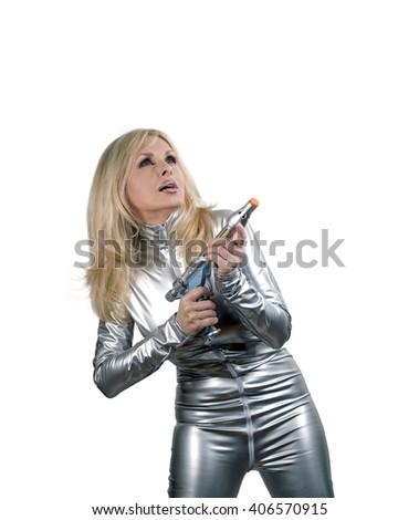 Caucasian woman in silver space suit holding a weapon against a digital render background.