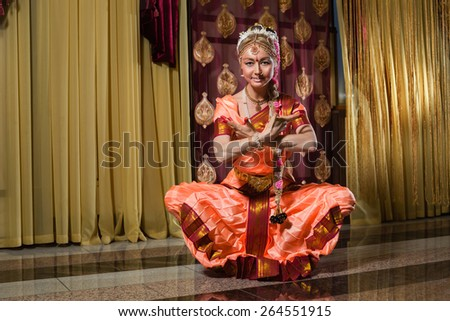 Caucasian woman in traditional indian dress is meditation. - stock photo