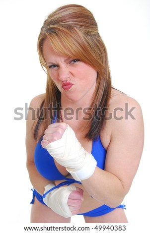 Caucasian woman kickboxing in full guard isolated on white. - stock photo