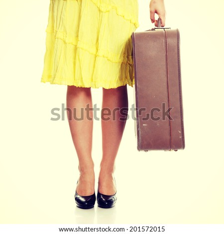 Caucasian woman legs with travel case. - stock photo