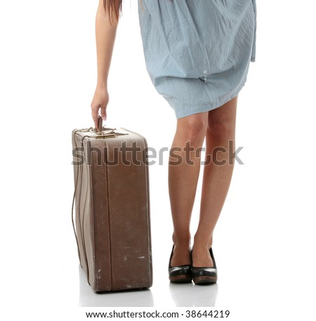 Caucasian woman legs with travel case isolated on white background - stock photo