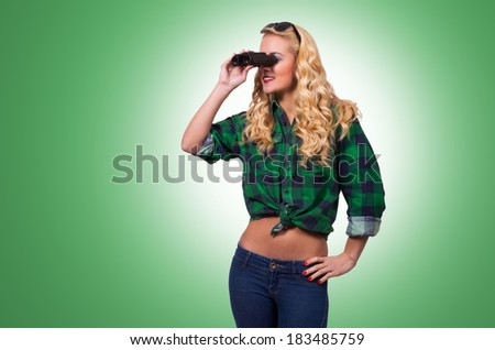 Caucasian Woman Looking Through Binocular - stock photo