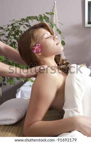 Caucasian woman preparing for massage at day spa. - stock photo