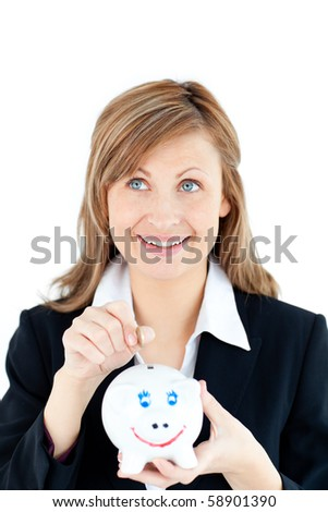 Caucasian woman putting money in a piggybank against white background - stock photo