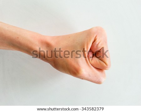 Caucasian woman's fist isolated on white background. Punch and confrontation concept.