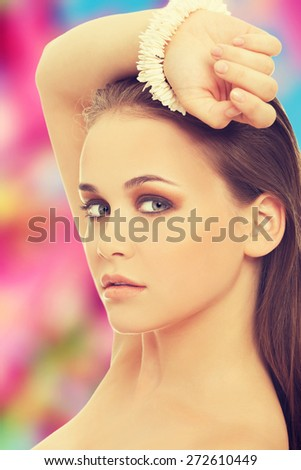 Caucasian woman sensual posing with bracelet - stock photo