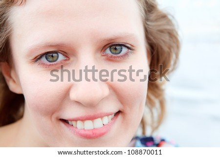 Caucasian woman smiling clean face close up. Copy space