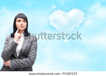 Caucasian woman thinking about love and looking pensive and happy in formal clothes