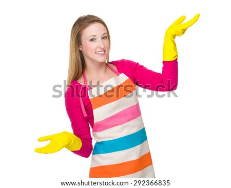 Caucasian woman using the rubber gloves on hand - stock photo