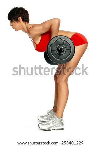 Caucasian woman with barbell wearing red training bikini isolated on white. - stock photo