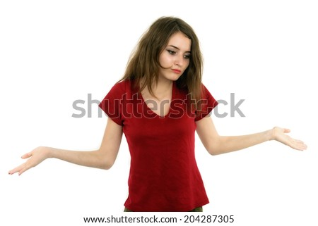 Caucasian woman with her both her empty palms extended sideways and a quizzical expression as she indicates that there is a choice or alternative, with copyspace for the placement of your products - stock photo