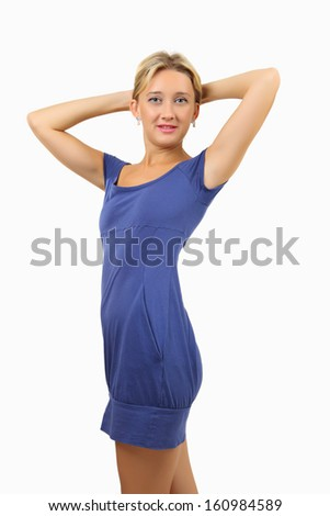 Caucasian woman, 34 years old, blonde, slim, in short, a fitting close, blue dress, held up her hands up and keep them behind the head, vertical image, isolated on white background. - stock photo